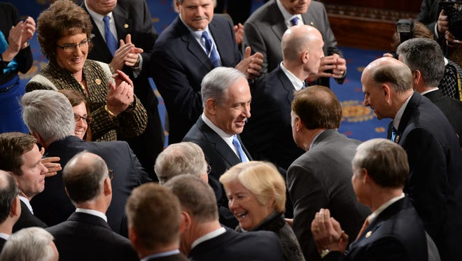 Benjamin Netanyahu, prime minister of Israel, enters the chamber to addresse a joint meeting of Congress on March 3, 2015.