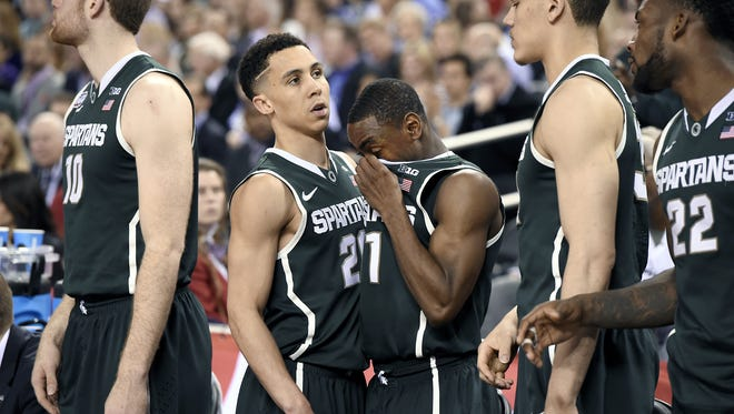 MSU's Matt Costello, Travis Trice, Lourawls Nairn Jr., Gavin Schilling and Branden Dawson react ather losing to Duke 81-61 in the Final Four on Friday in Indianapolis.