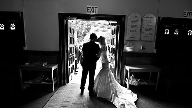 Anthony D'Ambrosio, 29, of Wall, N.J., shares a kiss with his former wife on their 2012 wedding day.