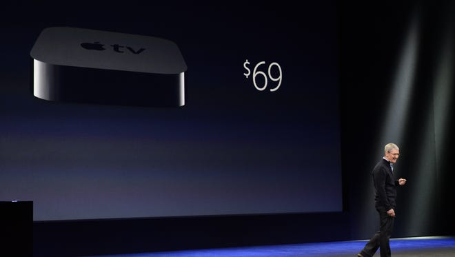 Tim Cook, CEO of Apple, announces a price drop on Apple TV to $69 on March 9, 2015, in San Francisco.