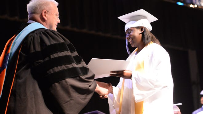 Shinay-Dine Geffrard receives her diploma Saturday during R.E. Lee High School's Commencement.