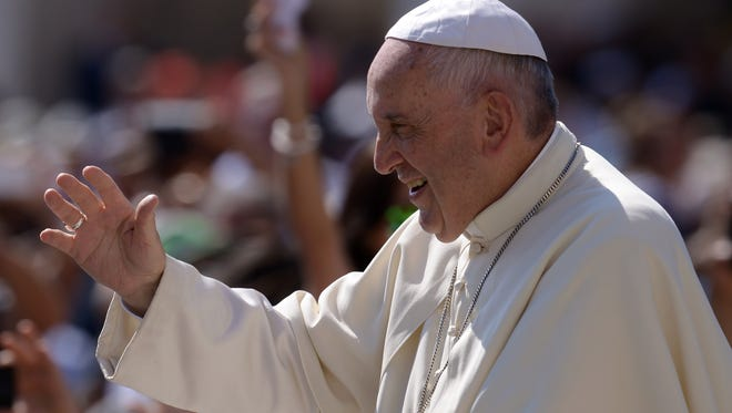 Pope Francis greets the crowd recently  at the Vatican.