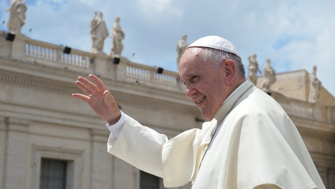 Pope Francis greets the crowd at the end of his weekly general audience at St Peter's square on June 17, 2015, at the Vatican.