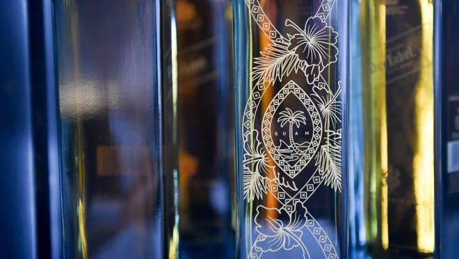 The limited edition Guam Johnnie Walker Blue bottle features a Guam seal, palm fronds and hibiscus flowers.