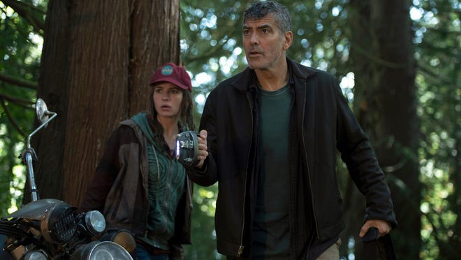 """Casey (Britt Robertson) and Frank (George Clooney go on an adventure in """"Tomorrowland."""""""