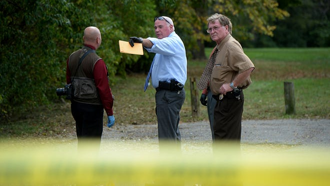 Detectives investigate the scene of a possible shooting Thursday, Oct. 8, 2015 at Middlefork Reservoir in Richmond.