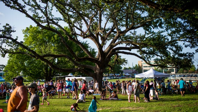 Fans dance to music by Geno Delafose & French Rockin' Boogie during the Levitt AMP Lafayette Music Series at the Horse Farm in Lafayette, La., Wednesday, July 8, 2015. The concert series is in its sixth week of a ten-week summer run.