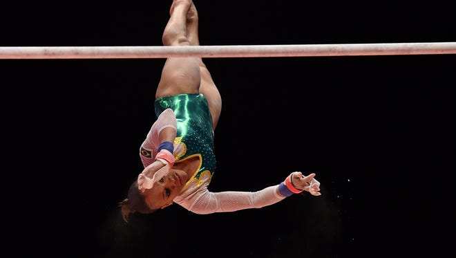 Brazil's Lorrane Oliveira competes on the uneven bars during the first day of qualifications at the 2015 World Gymnastics Championship in Glasgow, Scotland, on October 23, 2015.