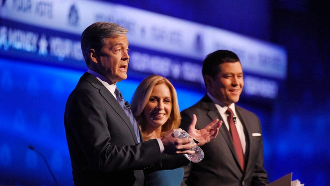 Debate moderators John Harwood, left, Becky Quick, center, and Carl Quintanilla take the stage during the CNBC Republican presidential debate at the University of Colorado, Wednesday, Oct. 28, 2015, in Boulder, Colo. (AP Photo/Mark J. Terrill)