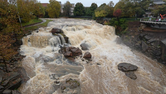 The Reedy River flows over Reedy River Falls in downtown Greenville, Monday, November 2, 2015.