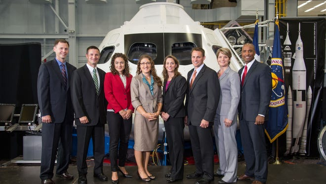The eight-member 2013 class of NASA astronaut candidates posed for a group portrait at Johnson Space Center on Aug. 20, 2013.
