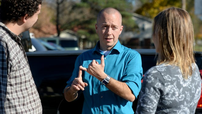 Richmond mayoral candidate Dave Snow talks to voters Tuesday, Nov. 3, 2015, at Townsend Community Center in Richmond.