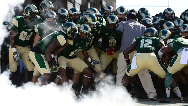 CSU football players huddle before taking the field for an Oct. 31 home game against San Diego State.