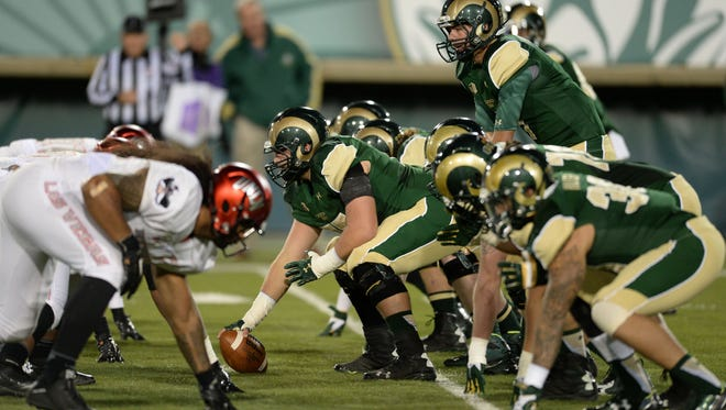 Quarterback Nick Stevens calls out signals at the line of scrimmage during the Rams' 49-35 win over UNLV last Saturday at Hughes Stadium.