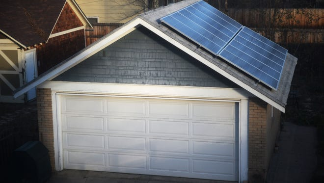 Barbra Liebler and Bill Jenkins have solar panels installed on the roof of their garage.  Liebler said she doesn't like the idea of relying solely on coal power.