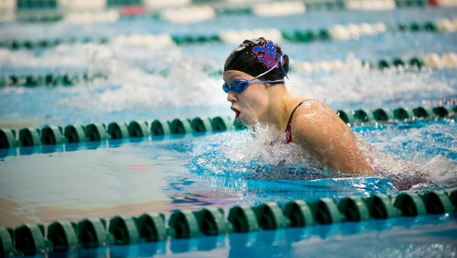 St. Clair swimmer Molly Likins competes in the 100 Yard Breaststroke at the state swim meet at Eastern Michigan University in Ypsilanti, Mich. on Saturday, Nov. 21, 2015.
