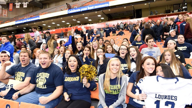 The fans that traveled from Poughkeepsie to Syracuse the day after Thanksgiving were supportive and vocal cheering for the Our Lady of Lourdes High School football team in the Class A state final.