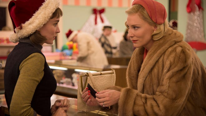 "This photo provided by The Weinstein Company shows, Rooney Mara, left, as Therese Belivet, and Cate Blanchett, as Carol Aird, in a scene from the film, ""Carol.""  The movie opens in U.S. theaters on Nov. 20, 2015.(Wilson Webb/The Weinstein Company via AP)"