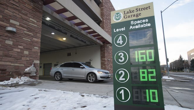 A car leaves the Lake Street Garage at CSU on Friday. The garage has sensors that communicate how many spaces are left on each level of the parking structure.
