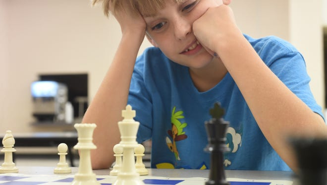 Archer Booth, 10, ponders his next move in a game of chess. Booth plays chess with other students at the Izard County Consolidated School District. The teams practice once a week and compete with the Chess Association for Arkansas Schools.