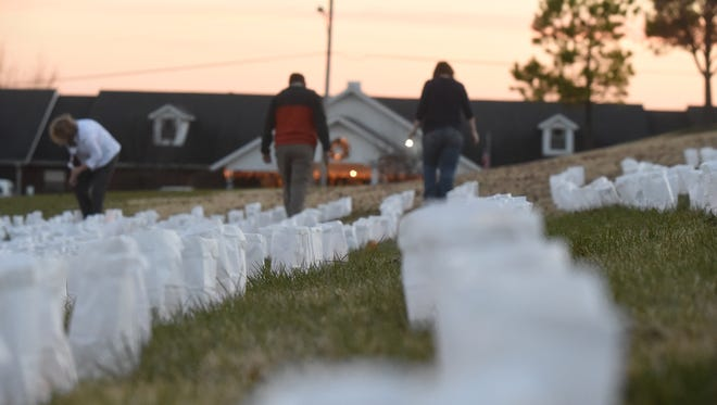 The 3,000 luminaries flickering outside Thursday, Dec. 10, 2015 represented the first 3,000 patients the Hospice House has served since opening in 2005. Hospice of the Ozarks commemorated the facility's 10th anniversary with an event in Mountain Home.