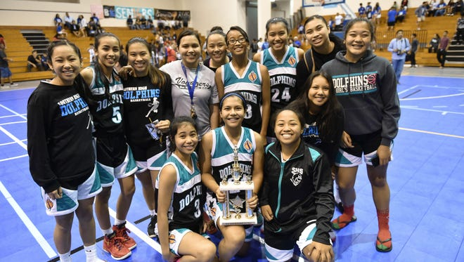 The Southern High Dolphins take third place in the IIAAG Girls' Basketball League championship games at the Southern High gym on Dec. 18.