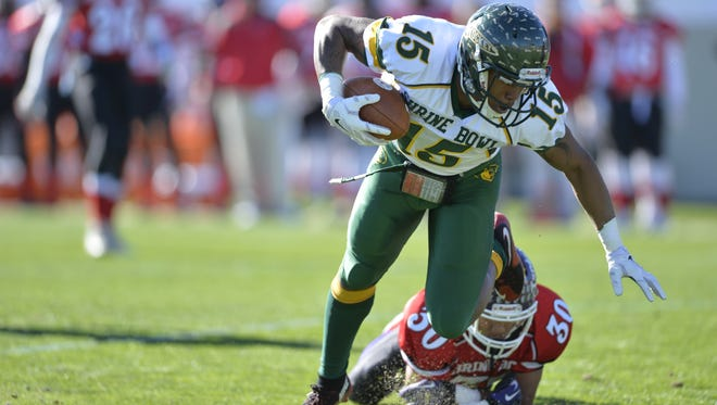 Reynolds' Rico Dowdle (15) scored two touchdowns in Saturday's Shrine Bowl in Spartanburg, S.C.