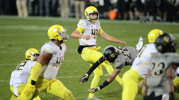 Oct 3, 2015; Boulder, CO, USA; Oregon Ducks place kicker Aidan Schneider (41) kicks a game tying field goal late in the second quarter against the Colorado Buffaloes at Folsom Field. Mandatory Credit: Ron Chenoy-USA TODAY Sports