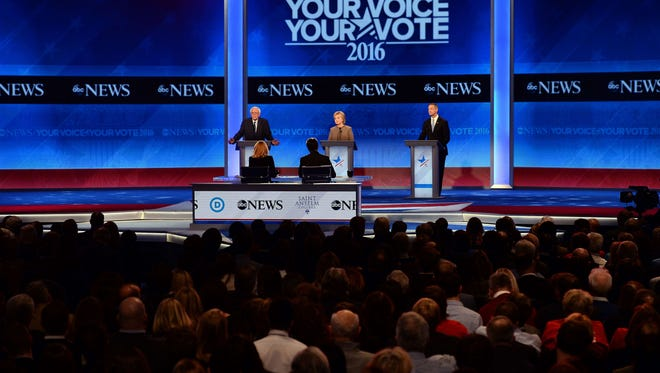 Bernie Sanders, Hillary Clinton and Martin O'Malley participate in the Democratic debate hosted by ABC News at Saint Anselm College in Manchester, N.H, on Dec. 19, 2015.