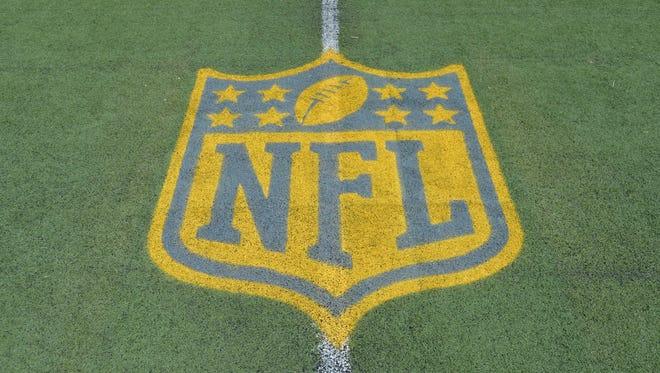 NFL golden shield logo to commemorate Super Bowl 50 at Tom Benson Hall of Fame Stadium.