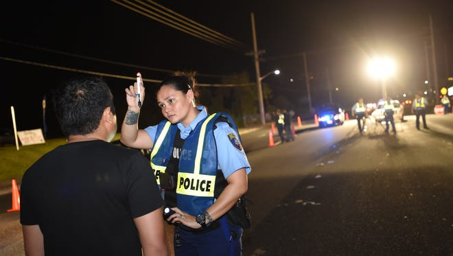 In this Dec. 30, 2015, file photo Guam Police Department Highway Patrol Division conduct a DUI checkpoint.