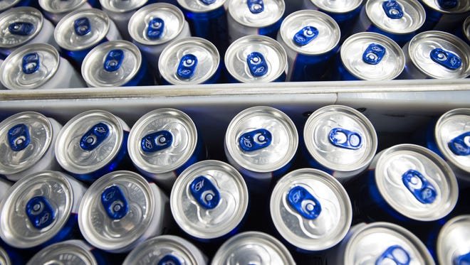 Cans of Michelob Ultra beer move down the canning line at the Anheuser-Busch facility in Fort Collins Wednesday, December 30, 2015. The St. Louis brewing company added a fourth canning line to its Northern Colorado location, adding 41 full-time manufacturing jobs.