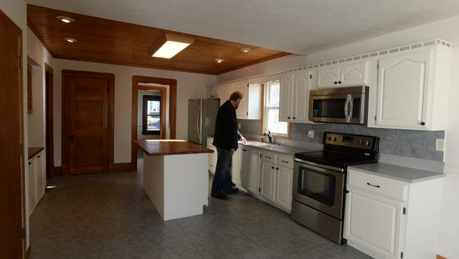 Chad Stegner inspects the kitchen of the William F. Bockhoff House at 36 S. 19th St. in Richmond. The house was recently renovated by the Richmond Neighborhood Restoration Inc.