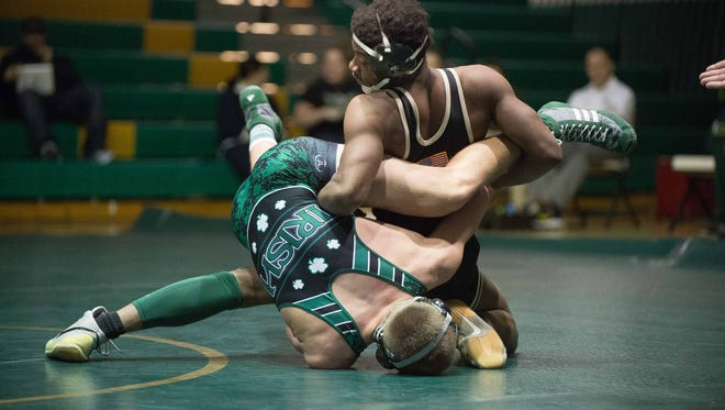 Seneca's Sam Jordan, right, beat Camden Catholic's Matt Cornely in the 180-pound weight class as in the Golden Eagles' 41-25 win on Wednesday in Tabernacle.