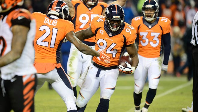 Dec 28, 2015; Denver, CO, USA; Denver Broncos outside linebacker DeMarcus Ware (94) celebrates the game winning fumble recovery in overtime against the Cincinnati Bengals at Sports Authority Field at Mile High. The Broncos defeated the Cincinnati Bengals 20-17 in overtime.