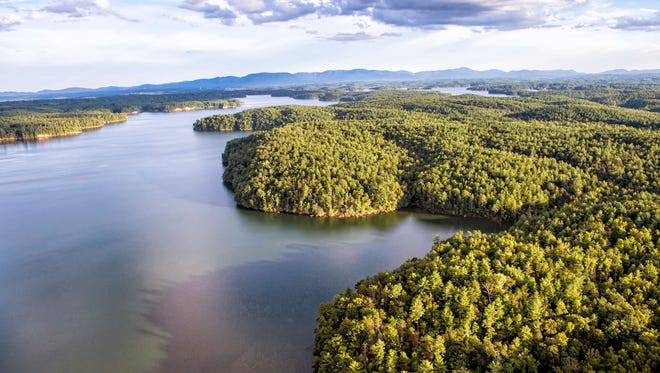 """A view of the Linville Arm of Lake James State Park looking southeast. The Linville Gorge is behind the photographer and the South Mountains are in the far distance past the lake. The 125-acre """"Lodge Tract"""" is in the center and has just been purchased by the state as part of Lake James State Park."""
