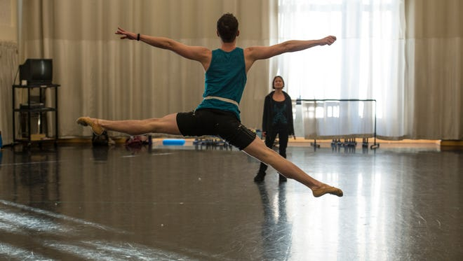 Louisville Ballet company member Rob Morrow dancing for choreographer and company ballet mistress Mikelle Bruzina in rehearsals for Studio Connections.