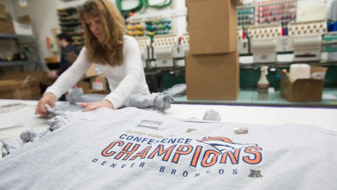 Mel Heltsley prepares to package Broncos t-shirts at Absolute Graphics Sunday, January 24, 2016. The print shop plans to produce over 3,000 shirts celebrating the Broncos 20-18 AFC championship win over the New England Patriots.