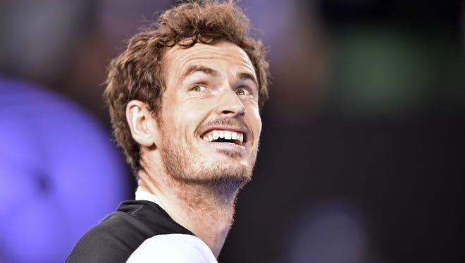 Britain's Andy Murray smiles after winning his men's singles semifinal match against Canada's Milos Raonic during the Australian Open on Jan. 29, 2016.