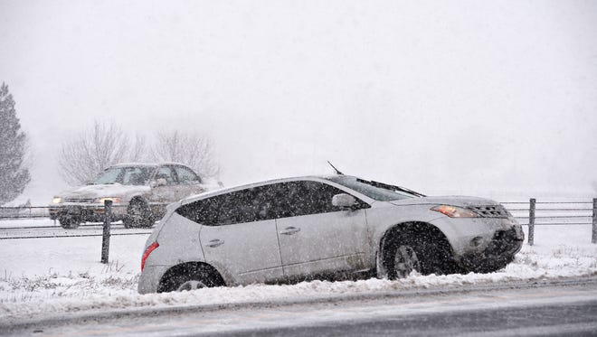 A vehicle tries to get out of the median on I-25 on Monday, February 1, 2016. Several cars were in the same predicament late Monday afternoon.