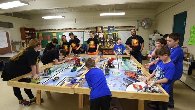 The Mountain Home Fire Tigers and the Mountain Home Ice Tigers run timed missions with their robots inside a classroom Tuesday, Feb. 9, 2016.