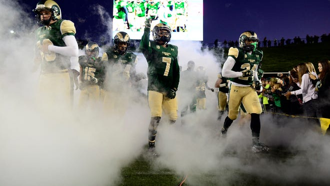 CSU players take the field at Hughes Stadium for a Nov. 14 game against UNLV. The Rams will open their new on-campus stadium in 2017 against Abilene Christian with a game two weeks later against Oregon State.