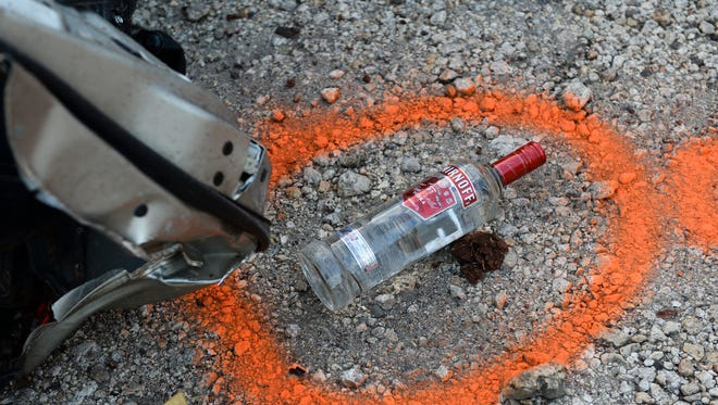 In this 2015 file photo, a bottle of alcohol was marked by the Guam Police Department at the scene of a car accident.