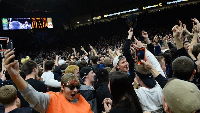 Colorado Buffaloes fans celebrate after defeating the Arizona Wildcats 75-72 on Wednesday at the Coors Events Center.