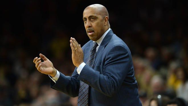 Washington men's basketball coach Lorenzo Romar during a game earlier this month at Colorado.