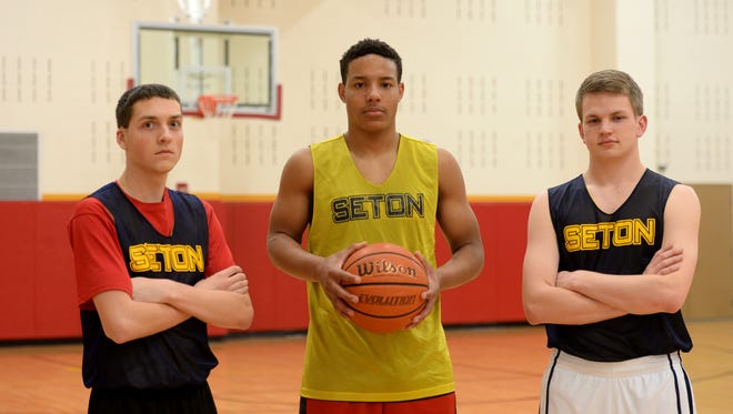 Seton Catholic High School seniors Colten Pipenger, left, Desmond Bane and Cliff Dickman during practice for basketball Tuesday, Feb. 23, 2016, in the Chuck Mosey Memorial Gym at Richmond.