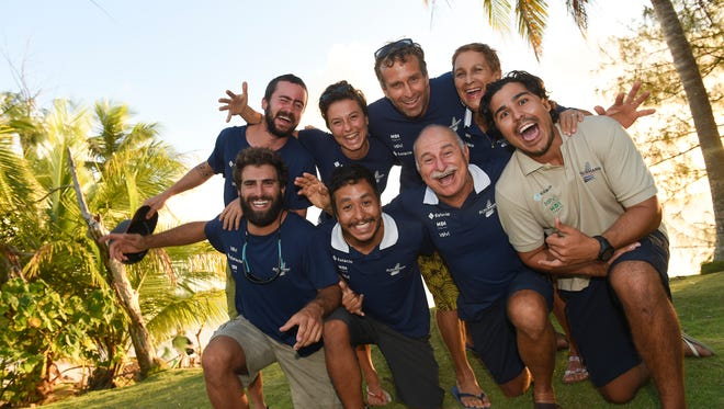 The Schurmann Orient Expedition crew get crazy for a group shot at the Marianas Yacht Club in Piti on Feb. 29.