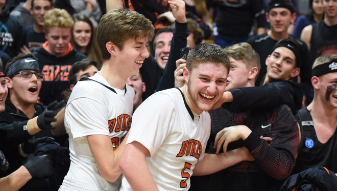 Marlboro's, from left, Joseph Nugent and Nicholas celebrate with the crowd after winning Wednesday's class B regional semi-final versus Briarcliff at Mount Saint Mary College in Newburgh.