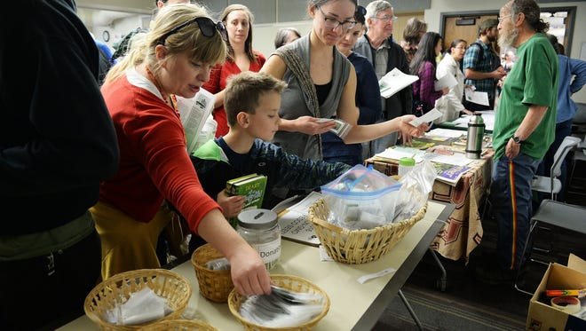Organizers estimate 430 people turned out for a seed swap and giveaway at the Old Town Library on Saturday, March 5, 2016.