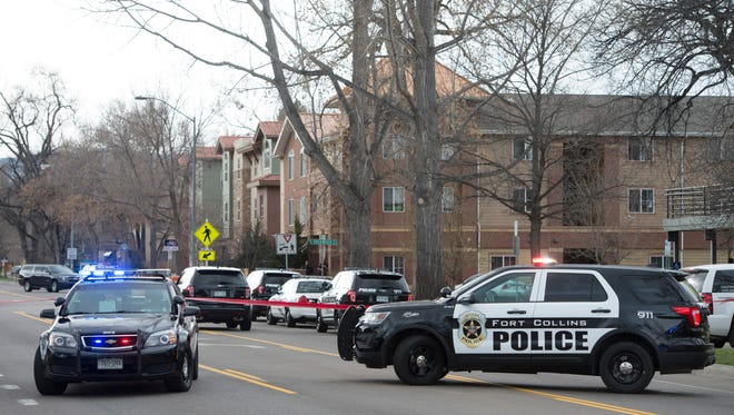 Fort Collins and CSU police respond to a call of an armed man in the area of Laurel St. and Sherwood St. Wednesday, March 16, 2016. The call turned out to be a hoax, according to law enforcement.